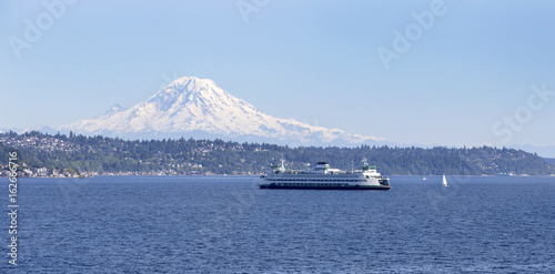 Passenger ferry boat sailing in Puget Sound with Mt Rainier in background