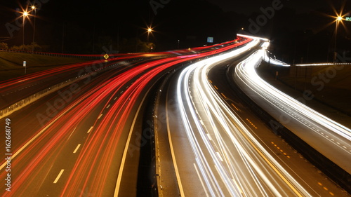 Photographie  Speed Traffic - light trails on motorway highway at night, long exposure abstrac