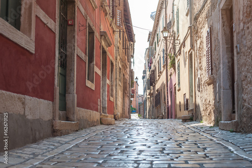 Photo Stands Narrow alley Coastal old town small narrow street