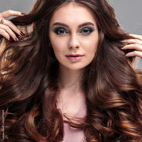 closeup beauty portrait of young woman with natural makeup and hairstyle. spa and care.
