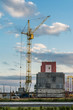 Building construction site with tower crane