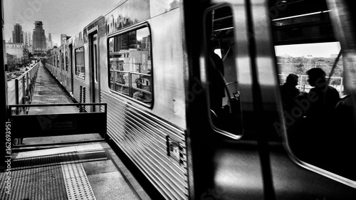 subway train and downtown in the background Fototapet