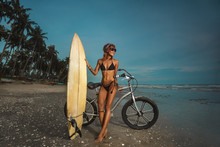 Girl With Surfboard And Bicycl...