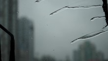 Slow Motion Of Rainy Day View During Car Windshield Wipers Rain Drops Sliding Down Inside A Car