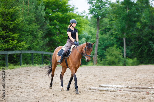 Photo Stands Horseback riding Horse rider is training in the arena