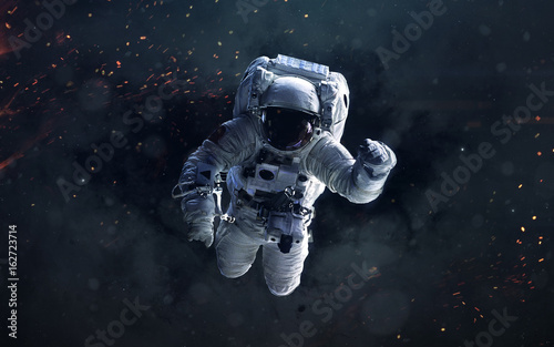Science fiction space wallpaper with astronaut, incredibly beautiful planets, galaxies, dark and cold beauty of endless universe. Elements of this image furnished by NASA