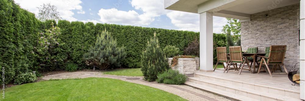 Fototapeta Terrace with garden furniture