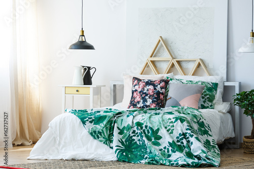 Green and white floral bedclothes Wallpaper Mural