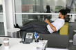 African business man relaxing after job at the office.