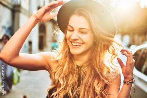 Portrait of young woman with hat smiling  - 162752326