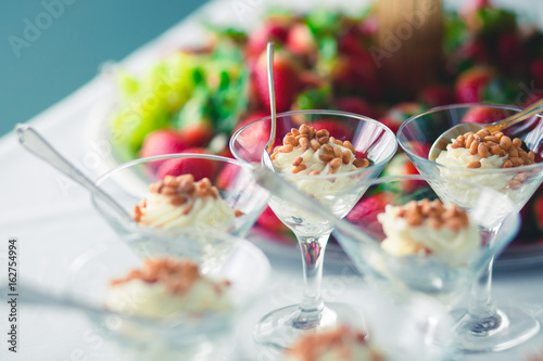 Foto auf Gartenposter Bar Decorated catering banquet table with different food appetizers assortment on a party