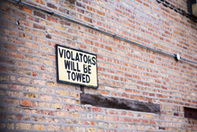 Violators Will Be Towed Sign O...