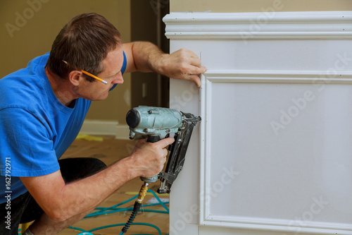 handyman nailed up Picture Moulding wall in the new house Tablou Canvas
