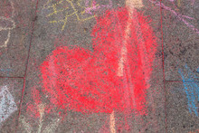 Drawing Red Heart Shape With Chalk On The Street Floor.