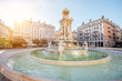 Leinwanddruck Bild - Morning view on Jacobins square and beautiful fountain in Lyon city, France