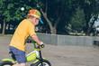young boy riding strider bike