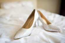 Bridal Shoes On The Bed