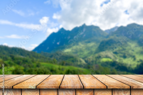 Foto  Wooden table on the beautiful mountain scenery background.