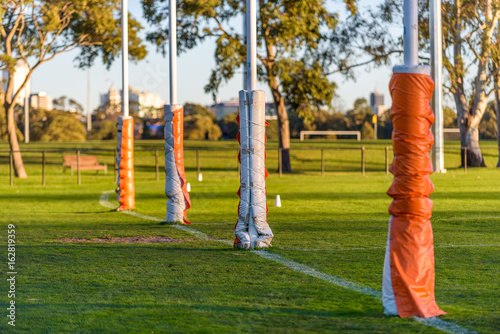 Four Australian football goal posts wrapped with protective padding at a footbal Canvas Print