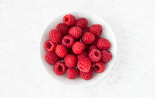 Closeup Of Raspberries In White Bowl