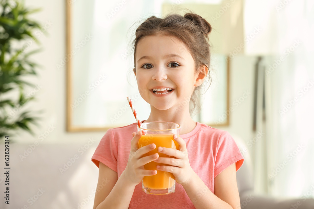 Fototapeta Cute little girl with glass of juice at home