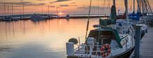 Sailboats At Sunrise In Marina