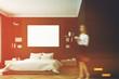 Black bedroom interior, woman