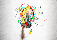 Blond Woman Drawing A Light Bulb