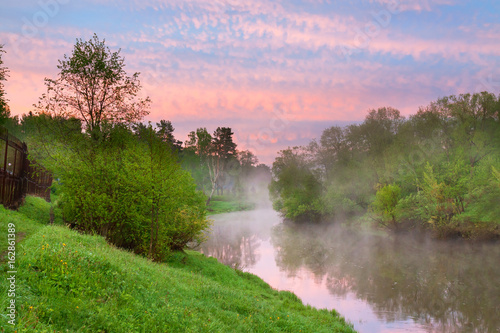 Poster Purple summer rural landscape with river, forest and fog at sunrise