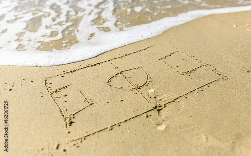 Soccer court drawn on the sand beach