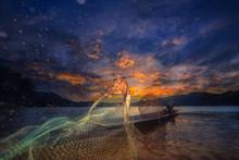 Asia Fishermen On Boat Fishing At Lake With Sunset.