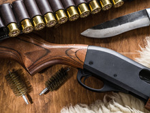 Pump Action Shotgun, 12 Mm Hunting Cartridge  And Hunting Knife.
