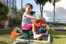 Asian Chinese Little Girl Sitt...