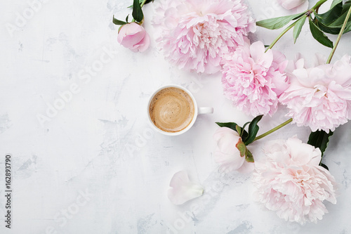 Obraz na plátně  Morning coffee and beautiful pink peony flowers on white stone table top view in flat lay style