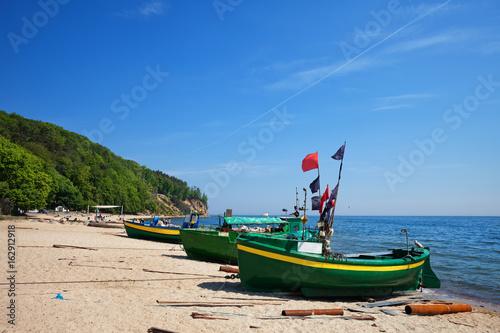 Obrazy na płótnie Canvas Baltic Sea Beach With Fishing Boats In Gdynia, Poland