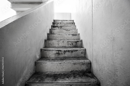 Spoed Foto op Canvas Trappen Dirty Stair Building, looking up to cement building. Modern architecture, cement Abstract architectural design