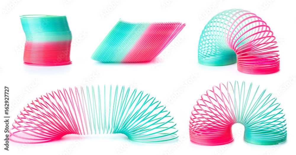 Fototapety, obrazy: Slinky spring toy isolated on white. Red and blue spring toy.