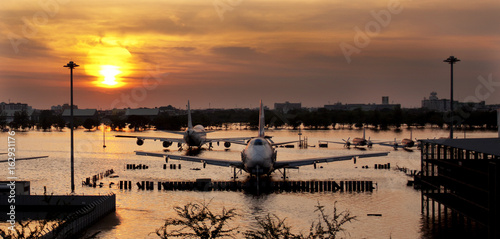 Bangkok ,Thailand - Nov 20, 2011: Sun rise at Don-Muang Airport and flooded © Voradech Triniti