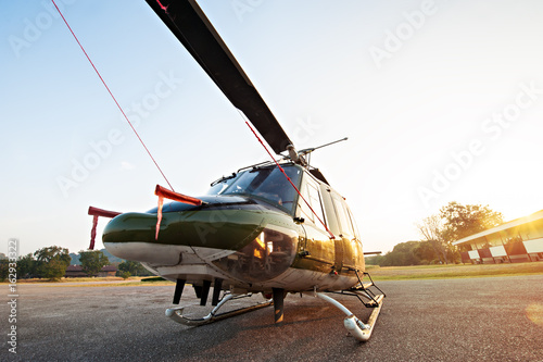 Tuinposter Helicopter Thai Army Helicopter is parking at the hangar in the morning with sunrise