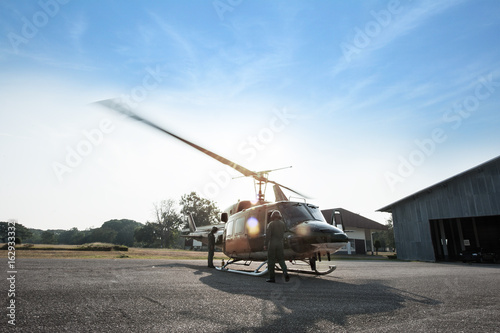 Tuinposter Helicopter The Army Helicopter parking at the hangar and preparing to take off.
