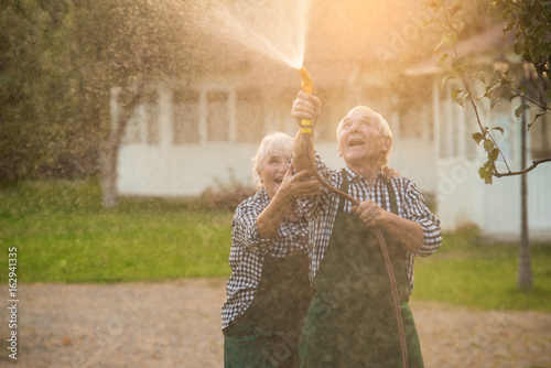 Elderly Couple With Garden Hose Old People Having Fun Buy This