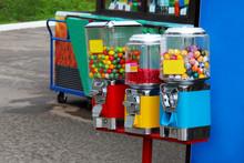 An Antique Gum Ball Machine Is...