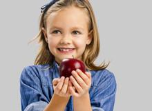 Cute Girl Holding An Apple