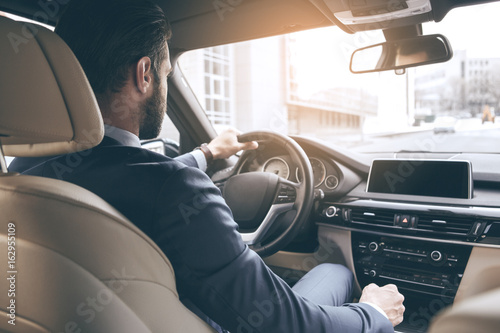 Fotografie, Obraz Young business man test drive new car