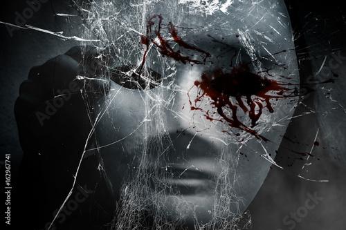 Obraz na plátně Mysterious woman in black wearing white mask hidden shattered glass ,Scary backg