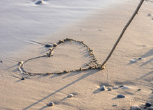 Heart Being Drawn In Clean Sand On The Beach With Stick
