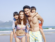 asian family vacationing on beach