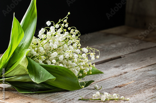 Wall Murals Lily of the valley Lilly of valley on wooden table. Copy space