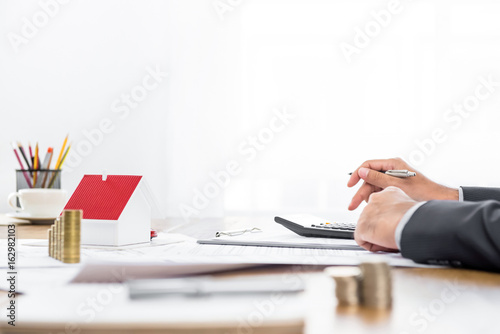Real estate agent working at the table Wallpaper Mural