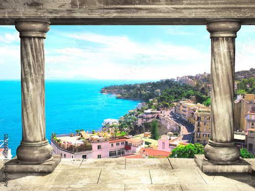 Poster Gris Columns and top view on Naples and Mediterranean sea, Italy